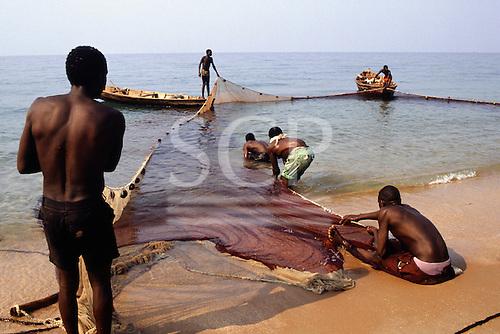 Ninde, Tanzania. Fishermen hauling in their nets on the shores of Lake Tanganyika.