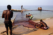 Ninde, Tanzania. Fishermen hauling in their nets on the shores of Lake Tanganyika.