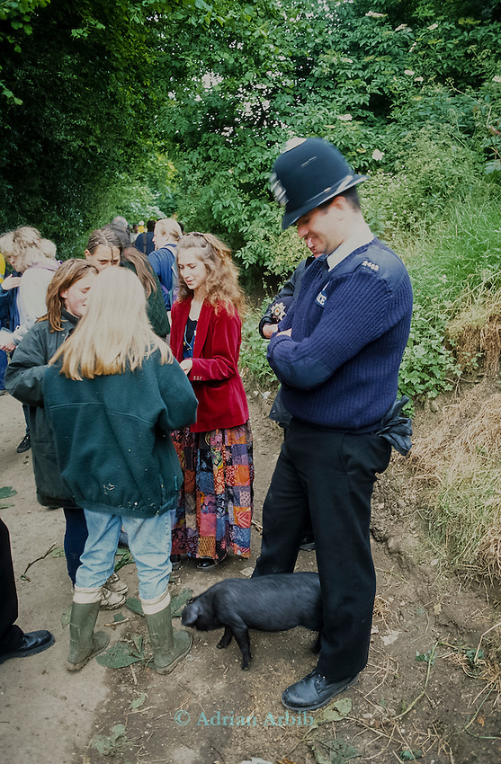 Policeman and Sulis the pig. Whitecroft woods.<br /> Solsbury Hill road protest.