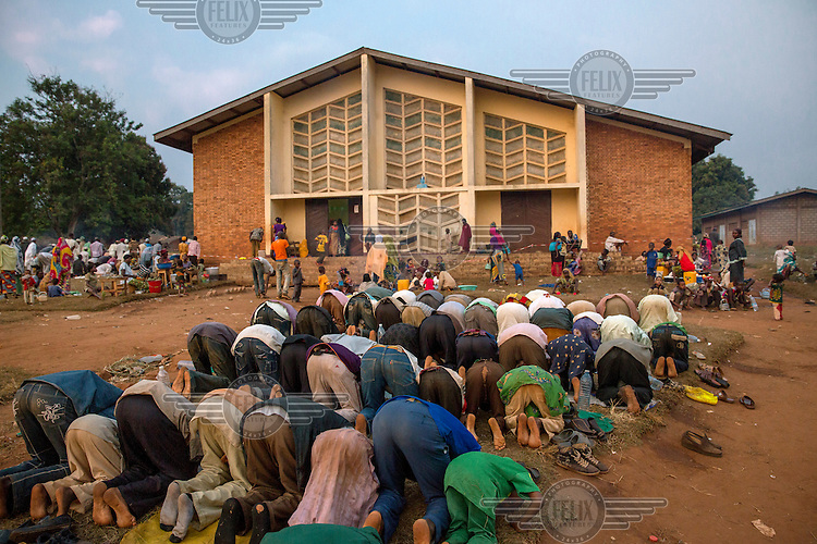 Muslims prey in front of a church where the priest had given them refuge from Christian Anti-Balaka fighters until French peacekeeping soldiers arrived to protect them. In 2013 a rebellion by a predominantly Muslim rebel group Seleka, led by Michel Djotodia, toppled the government of President Francios Bozize. Djotodia declared that Seleka would be disbanded but as law and order collapsed the ex-Seleka fighters roamed the country committing atrocities against the civilian population. In response a vigillante group, calling themselves Anti-Balaka (Anti-Machete), sought to defend their lives and property but they then began to take reprisals against the Muslim population and the conflict became increasingly sectarian. French and Chadian peacekeeping forces have struggled to contain the situation and the smaller Muslim population began to flee the country.