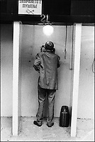 A man using the telephone at the main post office. Skopje, Macedonia, July 2000 © Stephen Blake Farrington<br />
