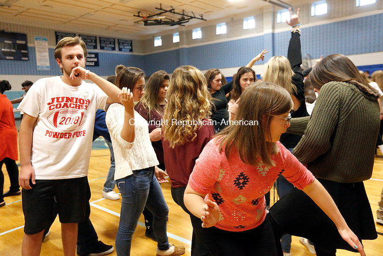 Oxford, CT- 17 November 2016-111716CM03-  Students from various schools throughout the Naugatuck Valley League, including Brad watts, 16, and Julia Fontano, 15 both from Wolcott during a CT Unified Sports Dance at Oxford High School on Thursday. Approximately 150 athletes, both special needs and non-disabled peers attended the event which featured music by Waterbury DJ Frank Calabro.    Christopher Massa Republican-American