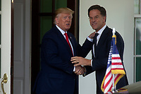United States President Donald J. Trump greets Prime Minister of the Netherlands Mark Rutte as he arrives to the White House in Washington D.C., U.S. on July 18, 2019. Photo Credit: Stefani Reynolds/CNP/AdMedia