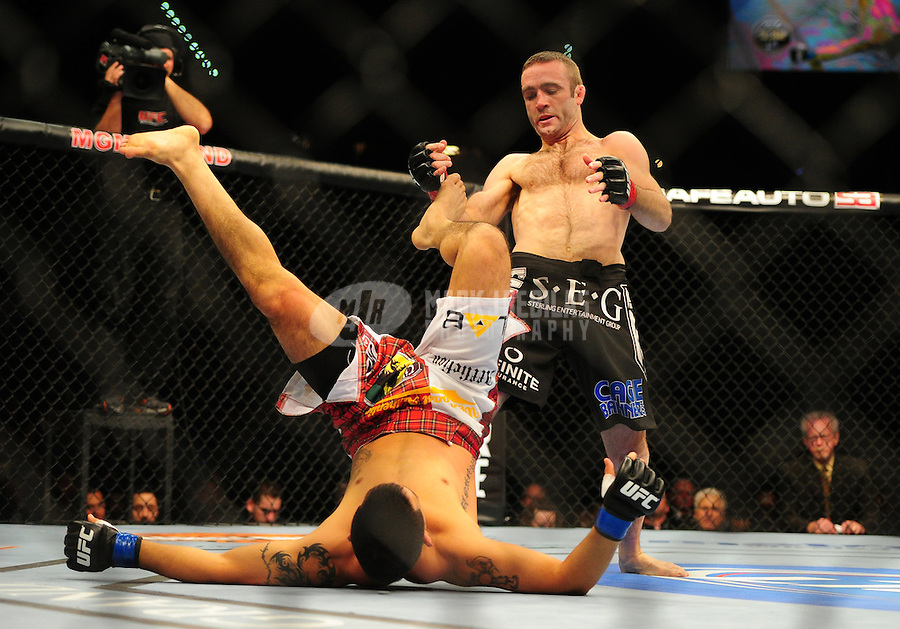 Dec 30, 2011; Las Vegas, NV, USA; UFC fighter Jacob Volkmann (right) against Efrain Escudero during a lightweight bout at UFC 141 at the MGM Grand Garden event center. Mandatory Credit: Mark J. Rebilas-