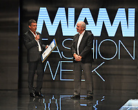 MIAMI, FL - MAY 30: Miami Dade County Mayor Carlos A. Gimenez presents Antonio Banderas with a proclamation at the Rene By RR Runway show during Miami Fashion Week at the Ice Palace Studios on May 30, 2019 in Miami Florida.    <br /> CAP/MPI04<br /> ©MPI04/Capital Pictures