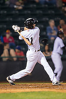 Josh Altmann (21) of the Hickory Crawdads swings so hard his elbow guard pops off his arm during the game against the Rome Braves at L.P. Frans Stadium on May 12, 2016 in Hickory, North Carolina.  The Braves defeated the Crawdads 3-0.  (Brian Westerholt/Four Seam Images)