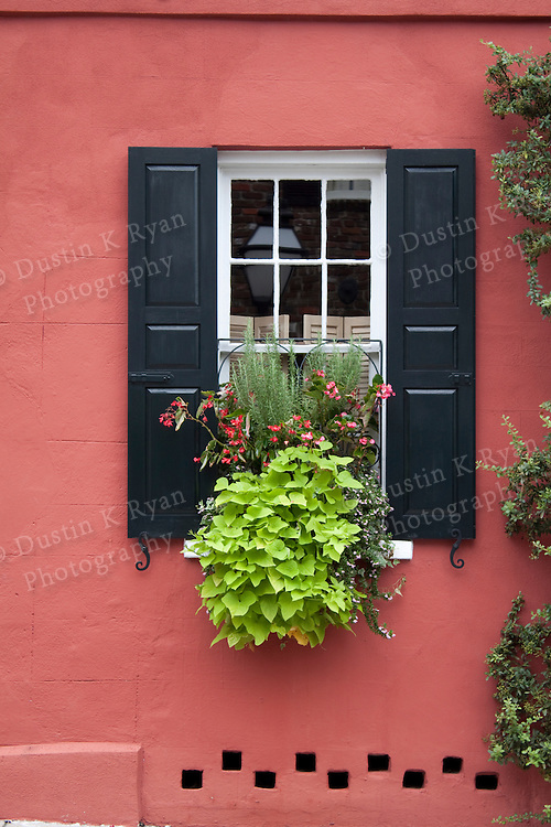 Historic Red House with beautiful flower box in the window