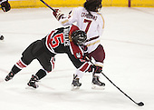 Kelly Wallace (NU - 5), Kristyn Capizzano (BC - 7) - The Boston College Eagles defeated the Northeastern University Huskies 3-0 on Tuesday, February 11, 2014, to win the 2014 Beanpot championship at Kelley Rink in Conte Forum in Chestnut Hill, Massachusetts.