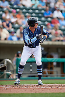 Columbus Clippers left fielder Richie Shaffer (8) squares around to bunt during a game against the Gwinnett Stripers on May 17, 2018 at Huntington Park in Columbus, Ohio.  Gwinnett defeated Columbus 6-0.  (Mike Janes/Four Seam Images)