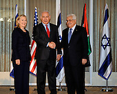 Prime Minister Benjamin Netanyahu of Israel (center) shakes hands with President Mahmoud Abbas of the Palestinian Authority (right) as United States Secretary of State Hillary Rodham Clinton (left) looks on at the Prime Minister's Residence in Jerusalem, Israel, on Wednesday, September 15, 2010. .Credit: Department of State via CNP.