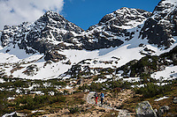 Two female hikers hiking in Tatra mountains, Poland