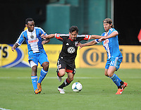 Carlos Ruiz (7) of D.C. United goes against Amobi Okugo (14) left and Jeff Parke (31) right. of the Philadelphia Union. The Philadelphia Union defeated D.C. United 3-2, at RFK Stadium, Sunday April 21, 2013.