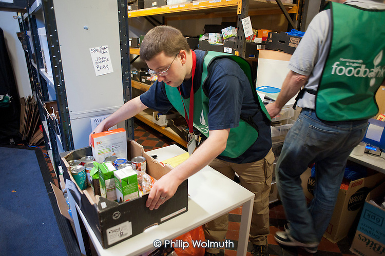 Volunteers preparing an order in the storeroom of Hammersmith & Fulham foodbank. The foodbank operates under the umbrella of the Trussell Trust, a Christian charity.
