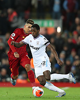 24th February 2020; Anfield, Liverpool, Merseyside, England; English Premier League Football, Liverpool versus West Ham United; Jeremy Ngakia of West Ham United shields the ball from Roberto Firmino of Liverpool
