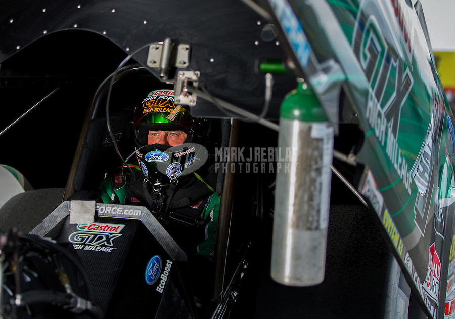 Aug 31, 2014; Clermont, IN, USA; NHRA  funny car driver John Force takes oxygen as he sits in his car during qualifying for the US Nationals at Lucas Oil Raceway. Mandatory Credit: Mark J. Rebilas-USA TODAY Sports