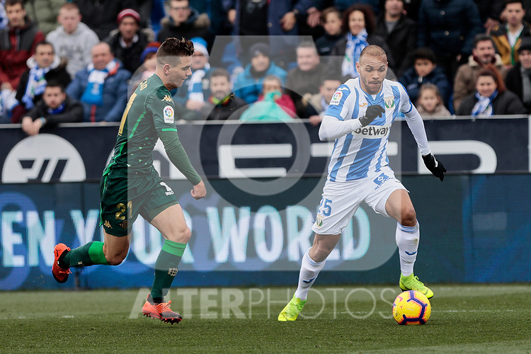 CD Leganes's Martin Braithwaite and Real Betis Balompie's Giovani Lo Celso during La Liga match between CD Leganes and Real Betis Balompie at Butarque Stadium in Madrid, Spain. February 10, 2019. (ALTERPHOTOS/A. Perez Meca)