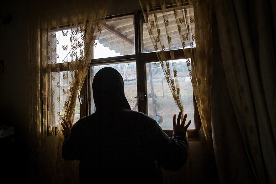 YAGLADI, TURKEY-- Feb 11. 2016-- Amina Abuzeyneb, 66, a Syrian refugee of Arab ethnicity, in the basement apartment where she lives with her daughters, one of whom is widowed, the other is the mother of a three-month old son. Her other three daughters are still in Latakia, Syria. Abuzeynep says it's difficult to live in Yagladi, where ethnic Arabs are given fewer advantages then the ethnic Turkmen.
