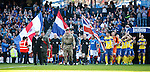 The teams are led out by servicemen on Armed Forces Day at Ibrox