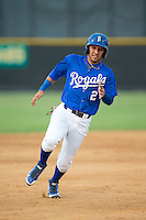 Jose Martinez (2) of the Burlington Royals hustles towards third base against the Danville Braves at Burlington Athletic Park on July 12, 2015 in Burlington, North Carolina.  The Royals defeated the Braves 9-3. (Brian Westerholt/Four Seam Images)