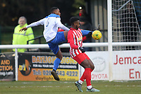 Jon Muleba of Enfield and Ira Jackson of Folkestone during Enfield Town vs Folkestone Invicta, BetVictor League Premier Division Football at the Queen Elizabeth II Stadium on 16th November 2019