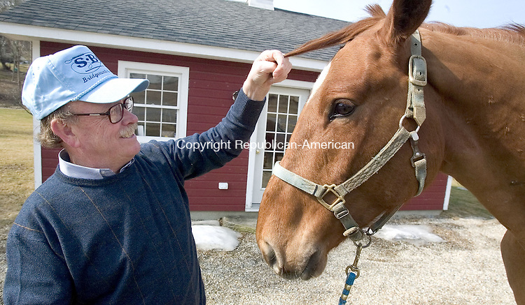 BRIDGEWATER, CT. 14 March 2007--15_NEW_031407SV01--First Selectman Bill Stuart of Bridgewater works with &quot;Lucky&quot; a Canadian Warm Blood at his farm in Bridgewater Wednesday.<br /> Steven Valenti Republican-American
