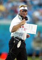 Tampa Bay Buccaneer head coach Jon Gruden walks from the field after checking on an injured player during an NFL preseason game in Jacksonville, FL on Friday, August 15, 2002.  Tampa bay won the game 20 to 0. (Photo by Brian Cleary/ www.bcpix.com )