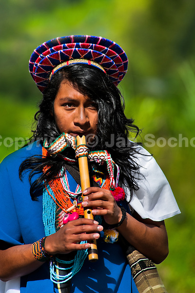 "A native from the Kamentsá tribe, wearing a colorful headgear, plays flute during the Carnival of Forgiveness, a traditional indigenous celebration in Sibundoy, Colombia, 12 February 2013. Clestrinye (""Carnaval del Perdón"") is a ritual ceremony kept for centuries in the Valley of Sibundoy in Putumayo (the Amazonian department of Colombia), a home to two closely allied indigenous groups, the Inga and Kamentsá. Although the festival has indigenous origins, the Catholic religion elements have been introduced and merged with the shamanistic tradition. Celebrating annually the collaboration, peace and unity between tribes, they believe that anyone who offended anyone may ask for forgiveness this day and all of them should grant pardons."