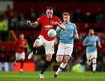 Phil Jones of Manchester United collects the ball in front of Kevin De Bruyne of Manchester City during the Carabao Cup match at Old Trafford, Manchester. Picture date: 7th January 2020. Picture credit should read: Darren Staples/Sportimage