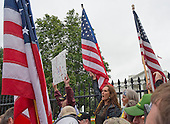"""Members of the """"Million Veterans March on the Memorials"""" protest the closing of the memorials on the National Mall due to the partial shut-down of the government on Pennsylvania Avenue near the White House in Washington, D.C. on Sunday, October 13, 2013.<br /> Credit: Ron Sachs / CNP"""