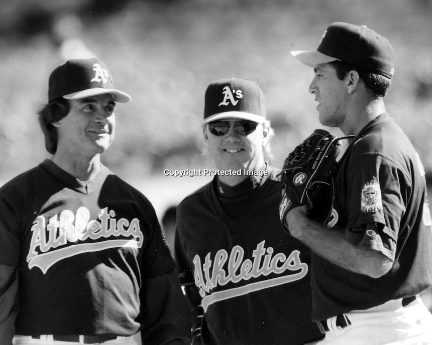 Oakland Athletics Manager Tony LaRussa, pitching coach Dave Duncan with pitcher Ariel Prieto. <br />