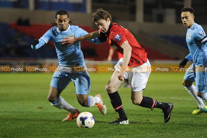 William Keane of Manchester United battles for the ball with Jason Denayer of Manchester City - Manchester United Under-21 vs Manchester City Under-21 - Barclays Under-21 Premier League Football at Salford City Stadium, Manchester - 27/01/14 - MANDATORY CREDIT: Greig Bertram/TGSPHOTO - Self billing applies where appropriate - 0845 094 6026 - contact@tgsphoto.co.uk - NO UNPAID USE