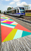 Photography of the Magic Carpet Mural along the Queen City's Rail Trail along  the LYNX Blue Line in the Southend of Charlotte, North Carolina.<br /> <br /> The LYNX Blue Line is the Charlotte region's first light rail service. It is 9.6 miles long and operates from I-485 at South Boulevard to Uptown Charlotte. <br /> <br /> Charlotte Photographer - PatrickSchneiderPhoto.com