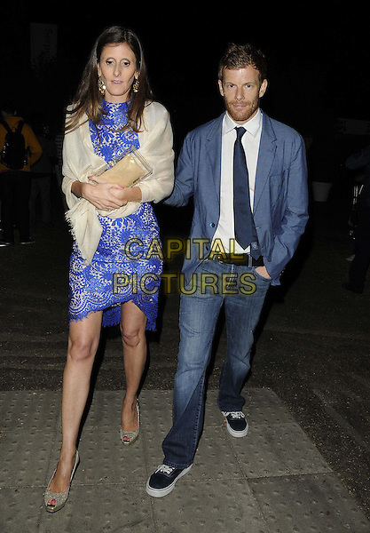 guest &amp; Tom Aikens<br /> The Serpentine Gallery Summer Party, Serpentine Gallery, Kensington Gardens, Hyde Park, London, England.<br /> June 26th, 2013<br /> full length blue suit white shirt dress lace jacket jeans denim white wrap shawl <br /> CAP/CAN<br /> &copy;Can Nguyen/Capital Pictures