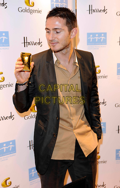 FRANK LAMPARD.Launches his signature gold iPod In support of The Teenage Cancer Trust, Harrods, Knightsbridge, London, England, UK, 3rd December 2009..half length ipod i-pod beige brown shirt suit jacket beard stubble facial hair black grey gray hand in pocket untucked .CAP/FIN.©Steve Finn/Capital Pictures.
