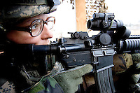 """Private First Class  Jennifer Baker, 26 years old from Esperia California and with Echo Company, 1st Battalion, 506th, 101st airborne Division is on tower guard at the front gate of  Combat Outpost ( C.O.P) in Eastern Ramadi, Al Anbar Province, Iraq on Tuesday JAN 12 2006. this is her second year in the military. she has not yet decided if she will reenlist. she says about the ARMY: """" I feel that the military has made me a very strong individual and I will never let myself down"""""""