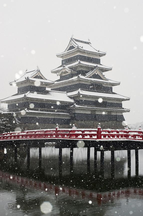 Matsumoto Castle and snowflakes, winter, Matsumoto, Nagano, Japan.