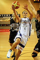 Saints guard Reece Cassidy during the NBL match between the Wellington Saints and Christchurch Cougars at Te Rauparaha Stadium, Porirua, Wellington, New Zealand on Saturday 4 April 2009. Photo: Dave Lintott / lintottphoto.co.nz