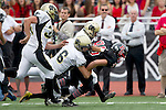 Palos Verdes, CA 11/10/11 - Matt Costa (Palos Verdes #85), Matt Hezlep (Peninsula #6) and Belal Awad (Peninsula #8) in action during the Peninsula-Palos Verdes varsity football game.