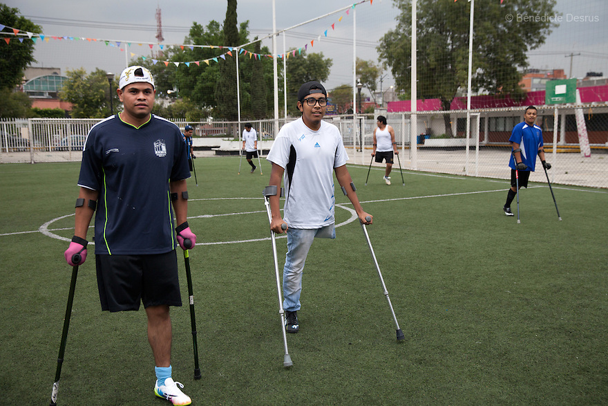 "Rodrigo (L) and Baruch (R), both players from Guerreros Aztecas, during a training session with the team in Mexico City, Mexico on June 26, 2014. Rodrigo Fernandez Loya, 25, lost his left leg in 2012 when he saved a girl from an onrushing train. Baruch Alejandro Anleu Ramirez, 18, had his left leg amputated due to bone cancer. Guerreros Aztecas (""Aztec Warriors"") is Mexico City's first amputee football team. Founded in July 2013 by five volunteers, they now have 23 players, seven of them have made the national team's shortlist to represent Mexico at this year's Amputee Soccer World Cup in Sinaloa this December. The team trains twice a week for weekend games with other teams. No prostheses are used, so field players missing a lower extremity can only play using crutches. Those missing an upper extremity play as goalkeepers. The teams play six per side with unlimited substitutions. Each half lasts 25 minutes. The causes of the amputations range from accidents to medical interventions – none of which have stopped the Guerreros Aztecas from continuing to play. The players' age, backgrounds and professions cover the full sweep of Mexican society, and they are united by the will to keep their heads held high in a country where discrimination against the disabled remains widespread. (Photo by Bénédicte Desrus)"