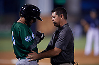 Daytona Tortugas trainer Clete Sigwart looks at Jonathan India (6) after being hit by a pitch during a Florida State League game against the Tampa Tarpons on May 17, 2019 at George M. Steinbrenner Field in Tampa, Florida.  Daytona defeated Tampa 8-6.  (Mike Janes/Four Seam Images)