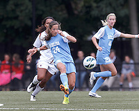 University of North Carolina midfielder Paige Nielsen (24) passes the ball.   University of North Carolina (blue) defeated Boston College (white), 1-0, at Newton Campus Field, on October 13, 2013.
