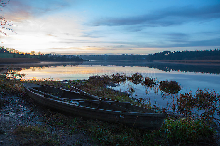 """A """"cot"""" or flat bottomed wooden fishing boat on the Slaney River, Wexford, on Christmas Day 2013"""