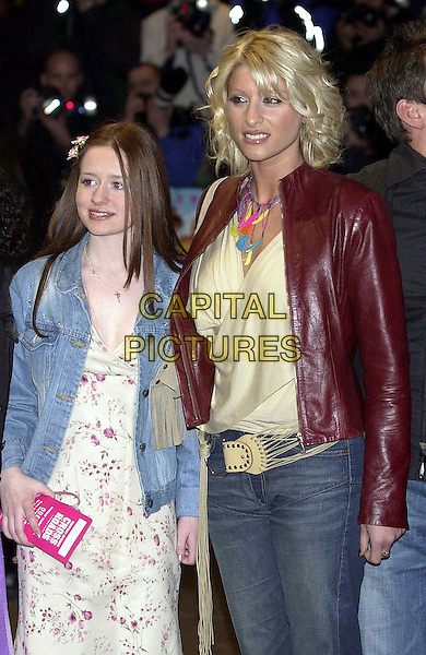 "DANI BEHR..Arrivals at ""Crossroads"" film premiere, Odeon cinema, Leicester Square.  ..half length, half-length, feather necklace, red leather jacket..www.capitalpictures.com..sales@capitalpictures.com..©Capital Pictures"