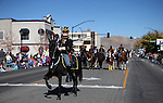 The 1st Nevada Cavalry ride in the 75th annual Nevada Day parade in Carson City, Nev., on Saturday, Oct. 26, 2013.<br /> Photo by Cathleen Allison
