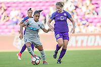 Orlando, FL - Sunday May 14, 2017: Debinha, Maddy Evans during a regular season National Women's Soccer League (NWSL) match between the Orlando Pride and the North Carolina Courage at Orlando City Stadium.
