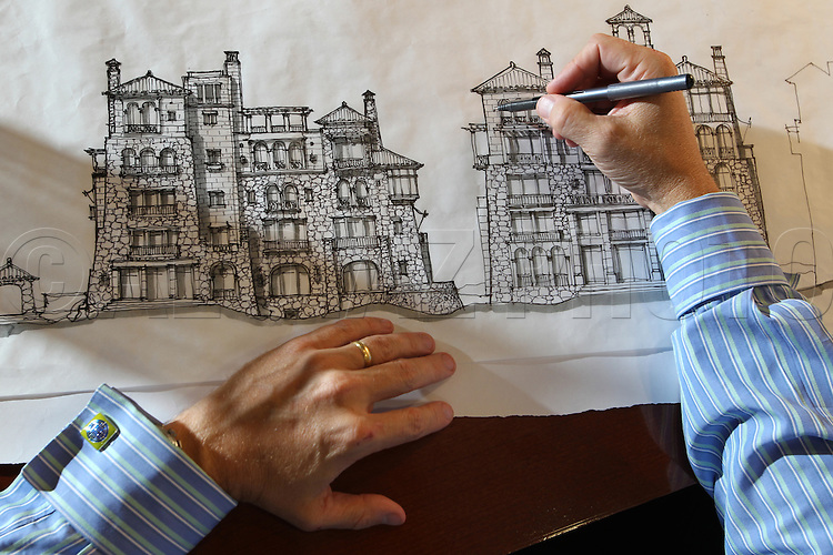 Joe Andriola has an excuse to be gun shy. Business is booming at his Coral Gables architectural firm, thanks to a mas.sive resort his office is designing in China. But after get.ting hammered by the recession -- Lehman Brothers cost SB Architects $1.5 million in 48 hours -- he's been reluctant to hire back staff shed during the scary times of 2008 and 2009. But now he is, warily. HIs office is an example of why .jobs have been slow to recover in this economy, as fears ho.ld back hiring.  This is Andriola doing a drawing at his office in Coral Gables on Thursday, July 15, 2010.