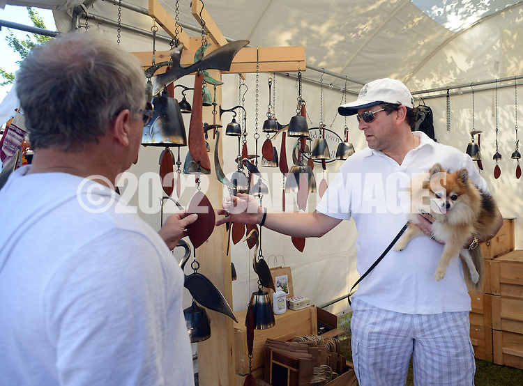 NEW HOPE, PA - SEPTEMBER 27:  Roy Scott (L) and Scott Stern (R) or New Hope, Pennsylvania along with their dog Dusty view bell chimes during the New Hope Arts Festival at New Hope-Solebury High School September 27, 2014 in New Hope, Pennsylvania. (Photo by William Thomas Cain/Cain Images)