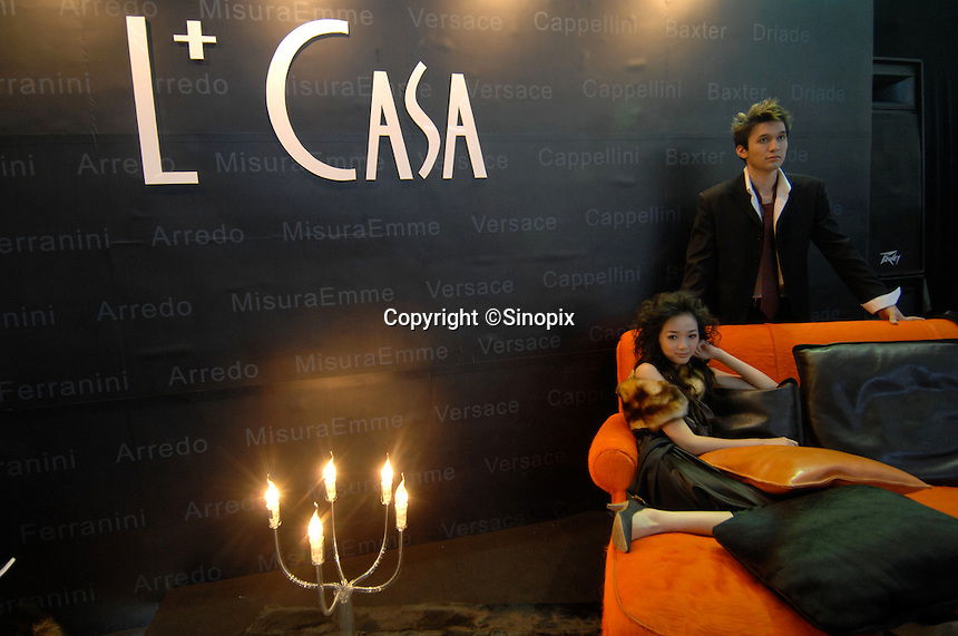"A model sits on a designer sofa at ""L+ Casa"" interior designers at the ""Top Show"" luxury goods fair in Shenzhen, China..18 Dec 2006"