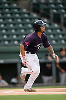 Catcher Alan Marrero (16) of the Greenville Drive runs out a batted ball in a game against the Delmarva Shorebirds on Friday, August 2, 2019, in the continuation of rain-shortened game begun August 1, at Fluor Field at the West End in Greenville, South Carolina. Delmarva won, 8-5. (Tom Priddy/Four Seam Images)