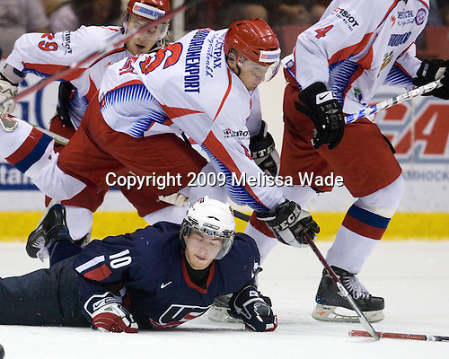 Anton Klementyev (Russia - 6), Vinny Saponari (US - 10) - Team Russia defeated Team USA 6-4 in their third game in the 1980/Herb Brooks (international-size) Rink on Friday, August 14, 2009, during the 2009 USA Hockey National Junior Evaluation Camp in Lake Placid, New York.